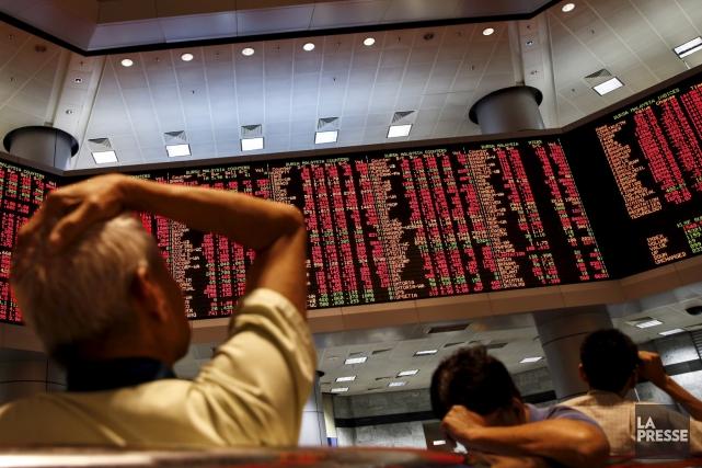 Des reculs importants ont observés sur les marchés... (AP, Joshua Paul)