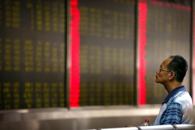 La Chine dominait toujours les préoccupations des investisseurs,... (AP, Mark Schiefelbein)