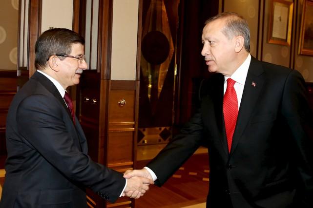 Le président Recep Tayyip Erdogan (à droite) a... (PHOTO YASIN BULBUL, REUTERS/PALAIS PRÉSIDENTIEL)