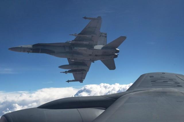 Pour Pierre Karl Péladeau les CF-18 font partie... (PHOTO ARCHIVES LA PRESSE CANADIENNE)