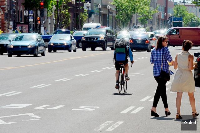 Les cyclistes sont invités à activer l'application mobile... (Photothèque Le Soleil, Erick Labbé)