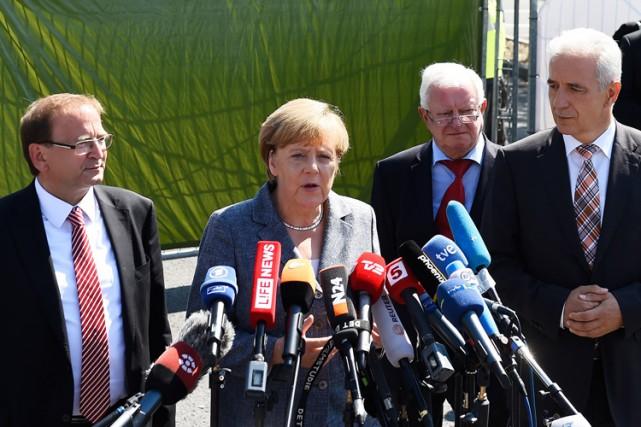 Angela Merkel a promis qu'elle ne ferait preuve... (PHOTO AP)