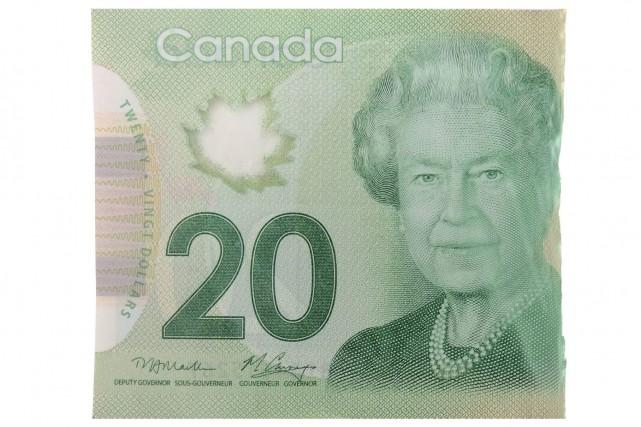 Les «demis», des billets de banque coupés en... (Infographie, Le Soleil)
