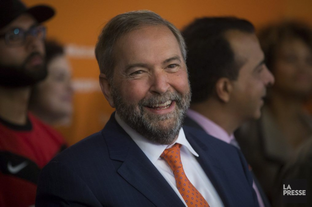 NDP Leader Tom Mulcair smiles during a campaign... (Photo Darryl Dyck, archives La Presse Canadienne)