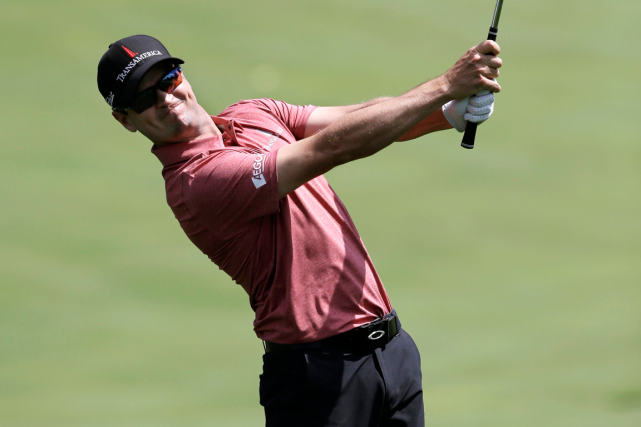 Zach Johnson a joué une ronde de 65, cinq... (Photo Mel Evans, AP)