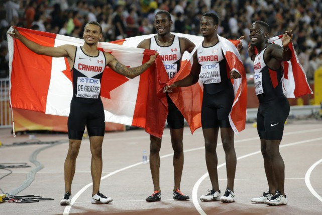 Andre De Grasse, Brendon Rodney, Aaron Brown et... (Photo Kin Cheung, AP)