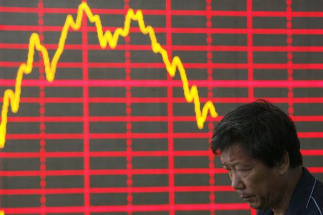 La Chine poursuit de douloureuses réformes structurelles, cherchant... (PHOTO ARCHIVES AP)