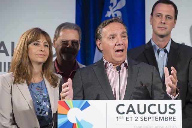 Entre le statu quo «déconcertant» de Philippe Couillard... (La Presse Canadienne, Jacques Boissinot)