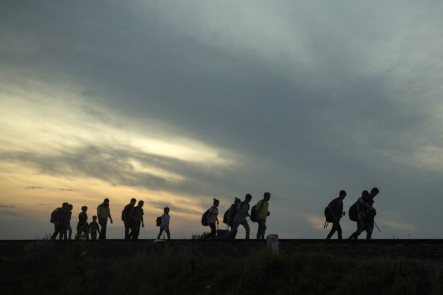Les pays occidentaux ont des politiques d'accueil très... (PHOTO SANTI PALACIOS, AP)