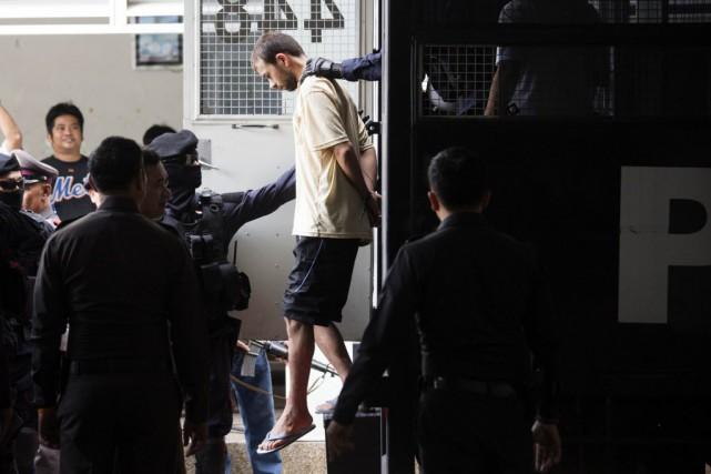 L'homme arrêté a comparu, samedi, dans le cadre... (Photo Wason Wanichakorn, AP)