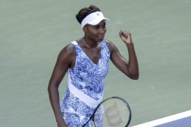 Venus Williams accède aux quarts de finale de... (Photo AFP)