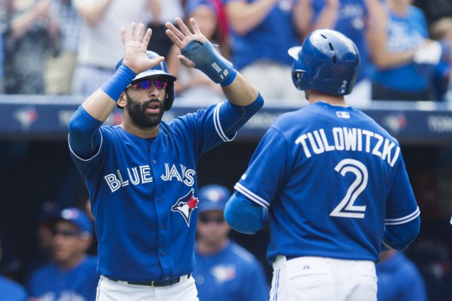 Jose Bautista, Troy Tulowitzki et Kevin Pillar ont... (Photo La Presse Canadienne)
