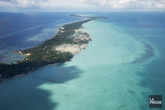 À Kiribati, ensemble de trois archipels au nord-ouest... (PHOTO MATTHIEU RYTZ, ARCHIVES LA PRESSE)