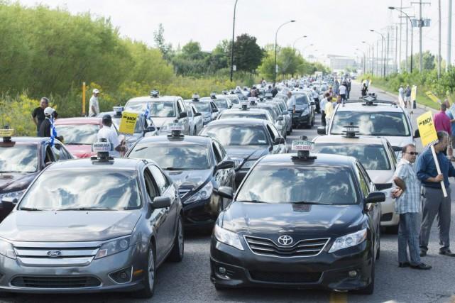 Il y a trois semaines, 3500 travailleurs du... (Photo Graham Hughes, La Presse canadienne)