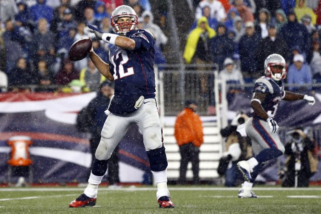 Tom Brady (12)... (PHOTO MARK L. BAER, USA TODAY SPORTS)
