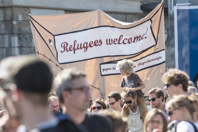 Selon un sondage, 60% des Allemands se disent... (PHOTO JENS MEYER, ARCHIVES AP)