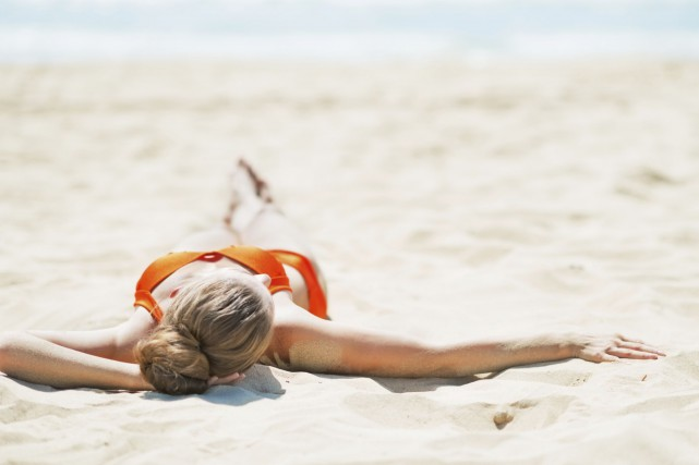 Les douces caresses du soleil de l'été vous ont laissé quelques mauvais... (Photo Digital/Thinkstock)