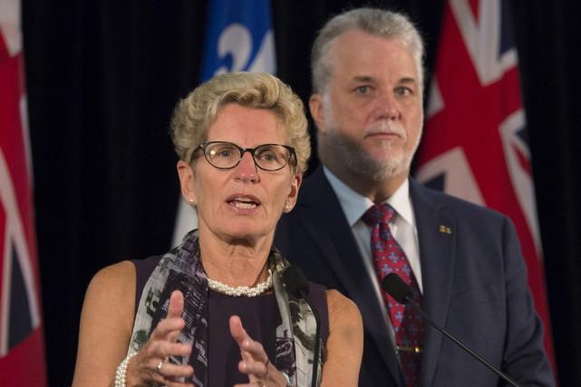 Kathleen Wynne et Philippe Couillardcroient qu'il est possible... (La Presse Canadienne, Jacques Boissinot)