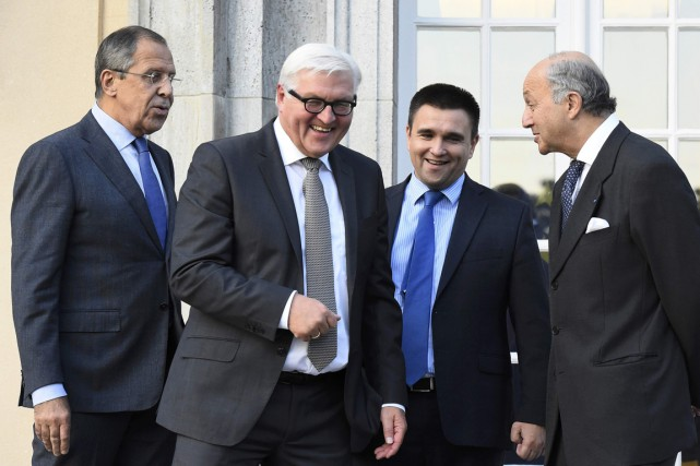 Les ministres des Affaires étrangères russe Sergei Lavrov,... (Photo Tobias Schwarz, Reuters)