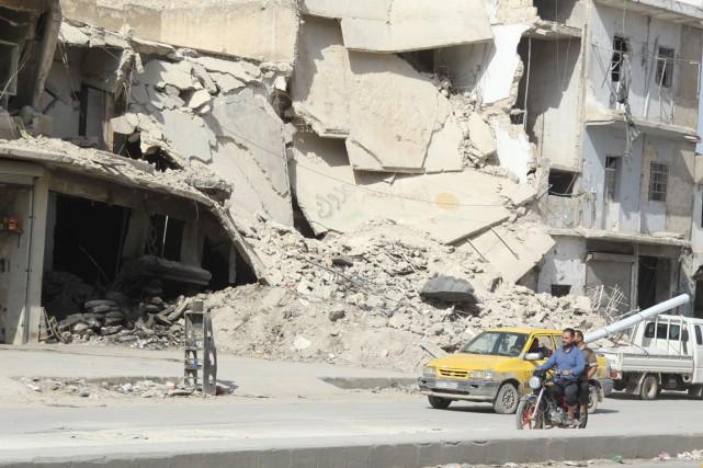 Alep, autrefois capitale économique de Syrie, est divisée... (Photo archives Reuters)