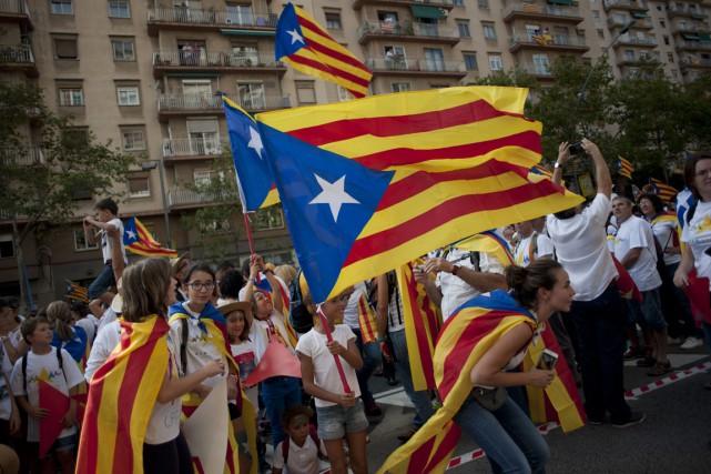 Des centaines de milliers d'indépendantistes ont célébré vendredi... (Photo archives AFP)