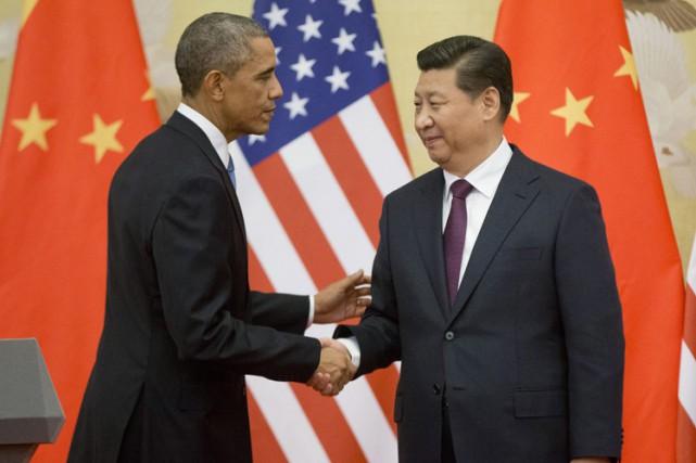Barack Obama et Xi Jinping à Pékin en... (ARCHIVES AP)