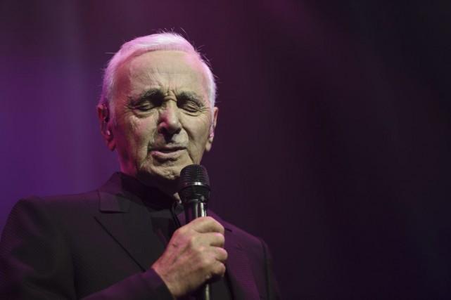 Charles Aznavour, maintenant âgé de 92 ans,sera en... (Archives AFP)