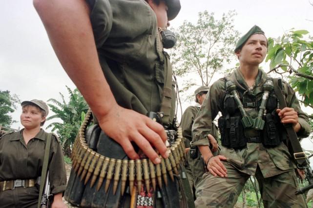 Des guérillerosdes Forces armées révolutionnaires de Colombie.... (Photo archives AFP)