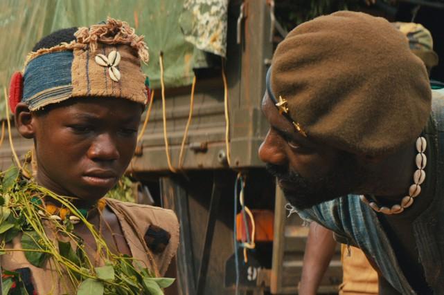 Abraham Attah et Idris Elba, dans le puissant... (PHOTO FOURNIE PAR NETFLIX)