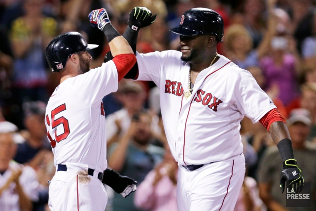 Dustin Pedroia et David Ortiz, des Red Sox... (Photo Charles Krupa, AP)