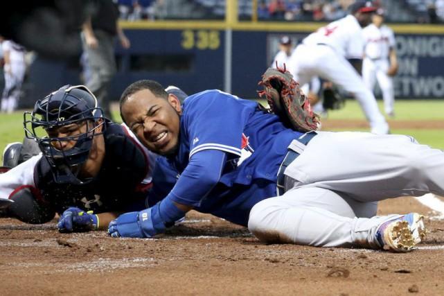 Marco Estrada et Roberto Osuna ont limité les frappeurs adverses à trois coups... (Photo USA Today Sports)