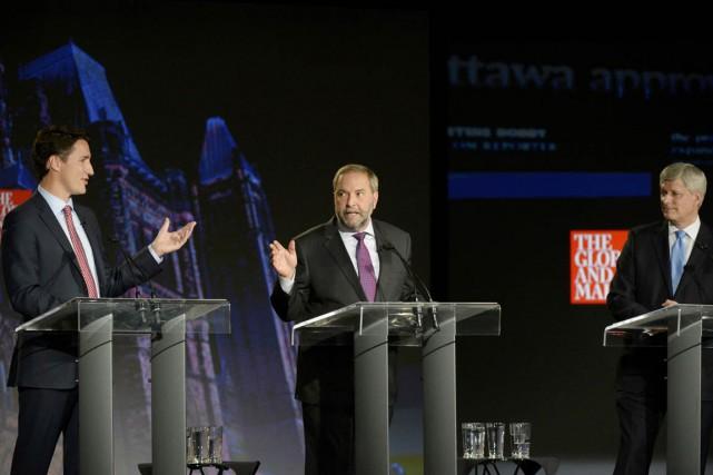 Justin Trudeau, Thomas Mulcair et Stephen Harper ont... (PHOTO MIKE STURK, REUTERS)