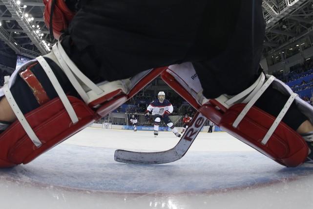 En matière d'impôt comme en matière de hockey,... (photoMATT SLOCUM, archives agence france-presse)