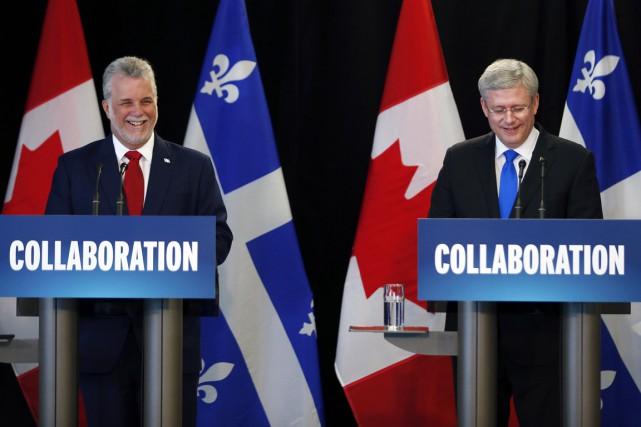 Philippe Couillard etStephen Harper, en juin 2014.... (Photo Mathieu Belanger, archives Reuters)