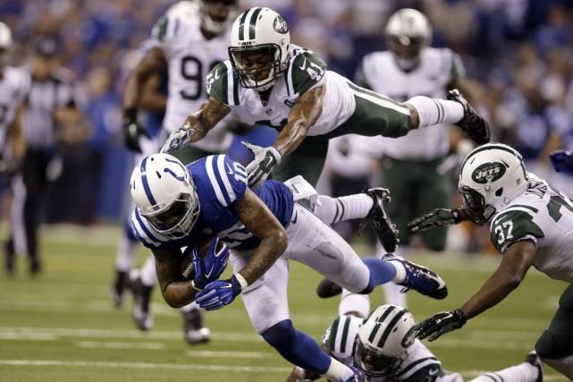La défense des Jets de New York, soudainement opportuniste, a refait le coup,... (PHOTO AP)