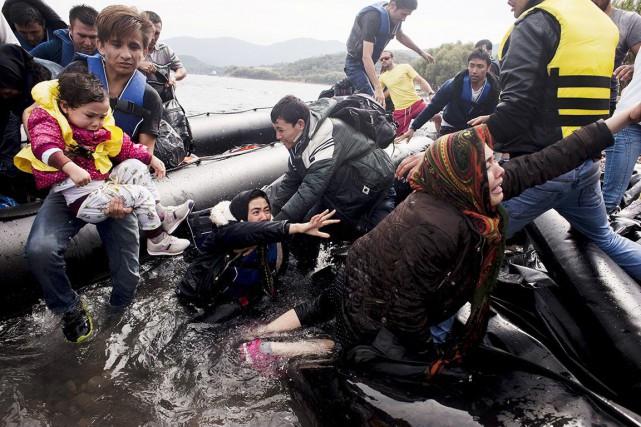 Alors que les réfugiés syriens continuent d'affluer en...