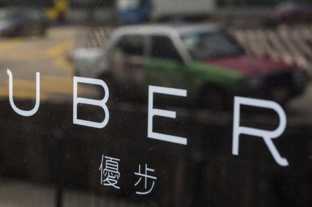 Le service mobile américain de réservation de voiture avec chauffeur Uber a... (PHOTO REUTERS)