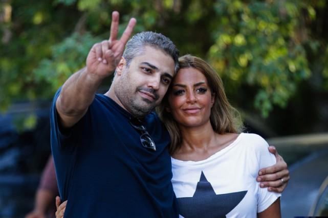 Mohamed Fahmy et sa femme Marwa Omara ont... (PHOTO AFP)