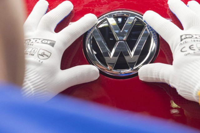 Y a-t-il un lien entre Volkswagen, le scandale... (Jens Meyer, Archives Associated Press)