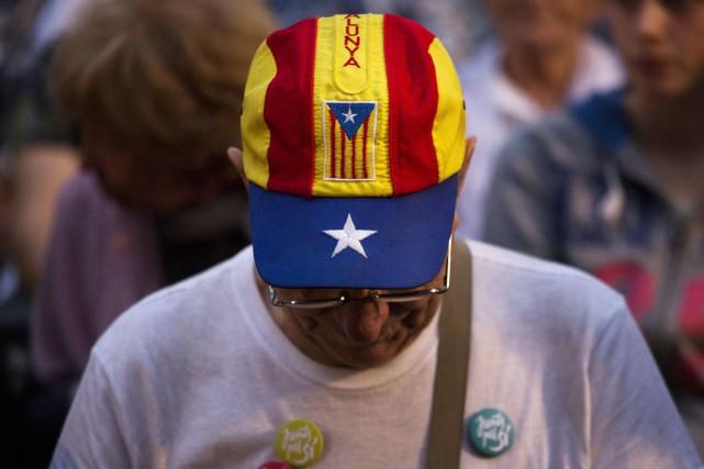 Un partisan de l'indépendance participe à un rassemblement... (PHOTO EMILIO MORENATTI, ARCHIVES AP)