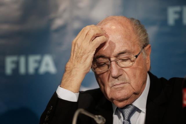 Le président démissionnaire de la FIFA, Sepp Blatter... (Photo Christophe Ena, archives AP)