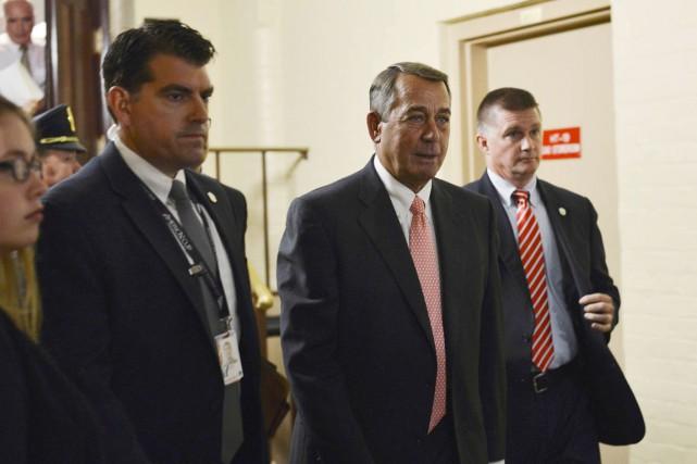 John Boehner (au centre) fait les frais d'une... (PHOTO JAMES LAWLER DUGGAN, REUTERS)