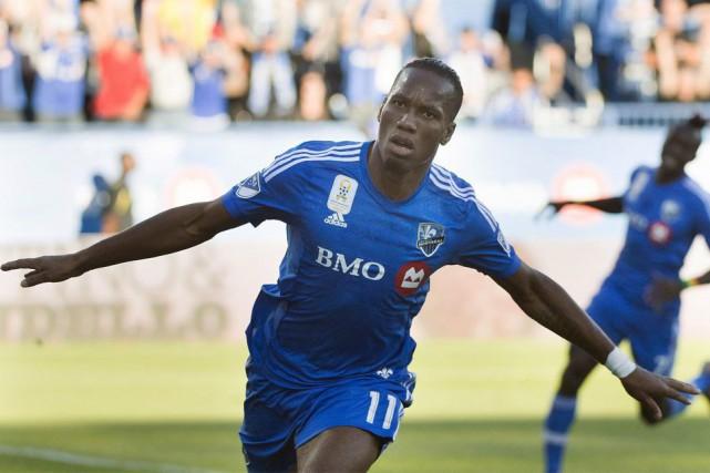 Didier Drogba a ajouté hier deux buts à... (La Presse Canadienne, Graham Hughes)