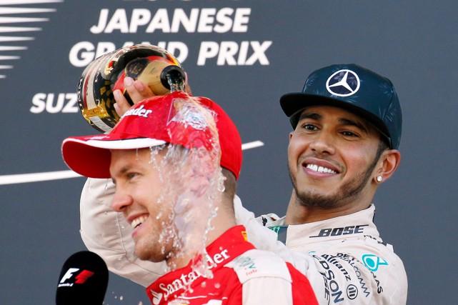 Vainqueur dimanche sur le circuit de Suzuka, Lewis... (AP, Toru Takahashi)