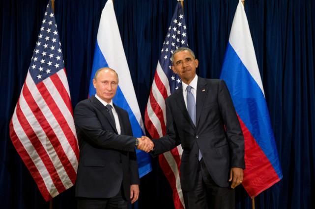 Les présidents russe et américain ont posé pour... (PHOTO AP)