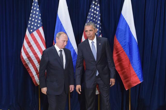 Barack Obama et Vladimir Poutine ont entamé lundi... (AFP, MANDEL NGAN)