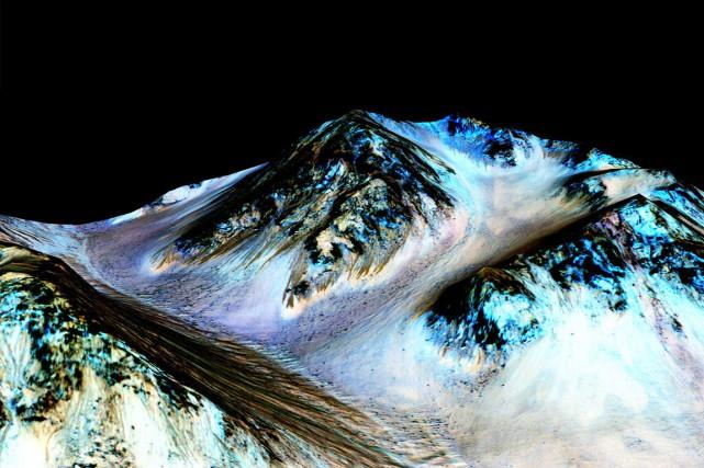 Des images prises par Mars Reconnaissance Orbiter révèlent... (AP, fournie par la NASA)