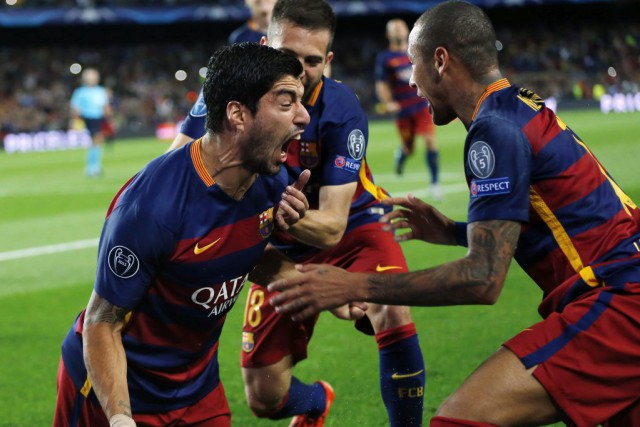 Luis Suarez célèbre son but.... (PHOTO AP)