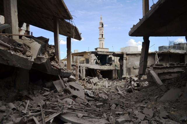 Les frappes contre les localités de Rastane, Talbissé... (PHOTO AFP)