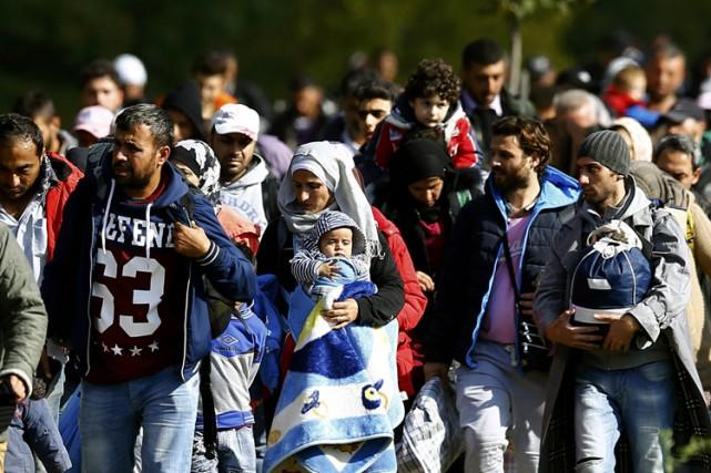 Les déplacements de population causés par les conflits... (PHOTO REUTERS)